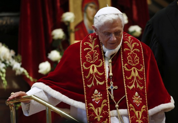 Pope Benedict XVI leaves at the end of a mass at the St. Peter's Basilica in the Vatican on Feb. 9, 2013. Pope Benedict will step down as head of the Catholic Church on Feb. 28, the Vatican confirmed on Monday, Feb. 11, 2013.