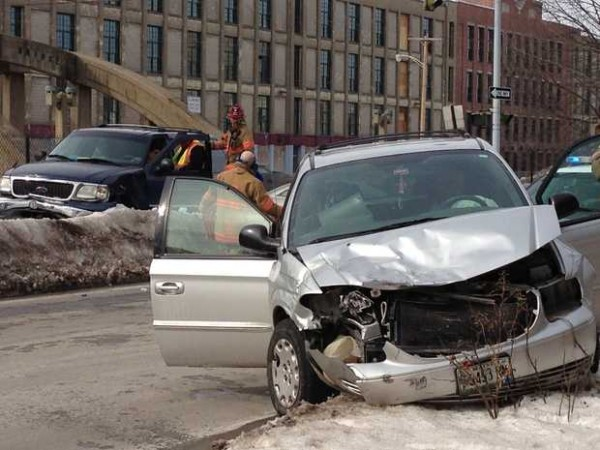 Emergency crews respond to a crash at the intersection of Chestnut and Canal streets in Lewiston on Tuesday, Feb. 19, 2013.
