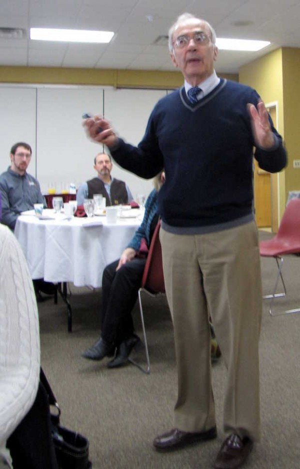 Darryl Brown, of Livermore Falls, project manager for Cianbro's proposed $2.1 billion east-west highway in Maine, presents the plan at a Franklin County Chamber of Commerce breakfast Tuesday, Feb. 19, 2013, at the University of Maine at Farmington.