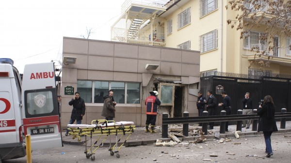 Security officers inspect the site after an explosion at the entrance of the U.S. embassy in Ankara.