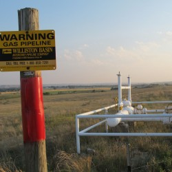 A natural gas pipeline runs across the prairie near Sidney, Montana. Maine's natural gas demand is expanding beyond what its pipelines can support.