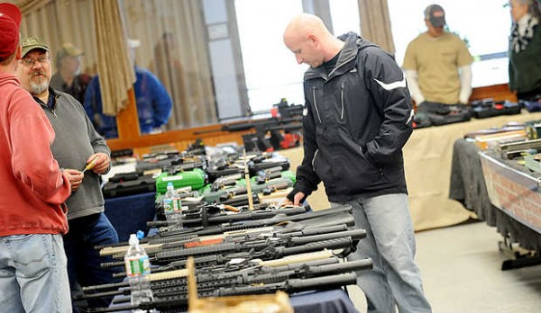 Jeffrey Hart checks out JT Reid's Gun Shop's wares at its annual winter gun show in Lewiston on Saturday.