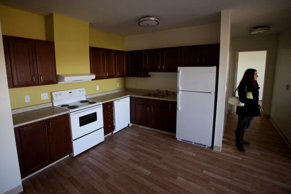 Mindy Woerter of Avesta Housing shows off an apartment in her organization's 184 Pearl St. building in Portland's Bayside neighborhood.