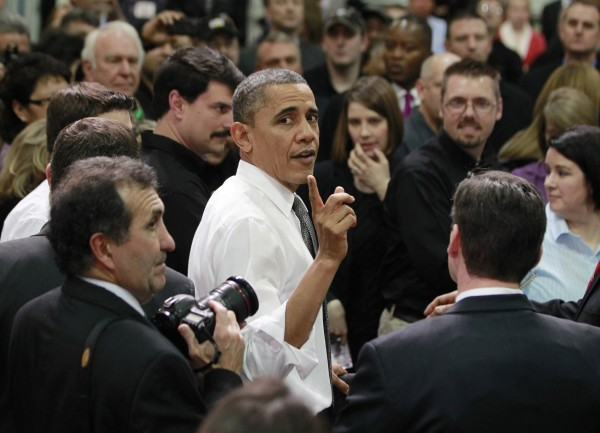 U.S. President Barack Obama meets workers in the audience following remarks at Linamar Corporation, a manufacturer of parts for the truck industry in Arden, North Carolina, Feb. 13, 2013.