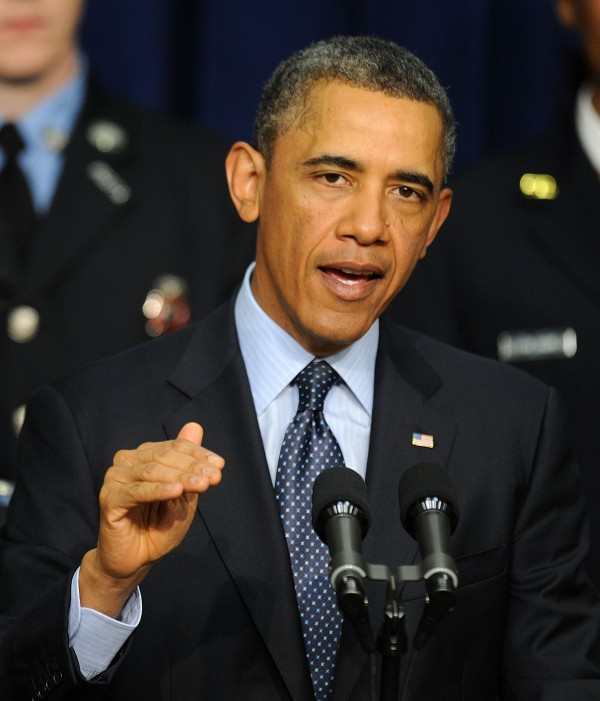 Surrounded by first responders who may be impacted by looming budget cuts, U.S. President Barack Obama speaks during an event at the Eisenhower Executive Office Building February 19, 2013 in Washington, D.C.