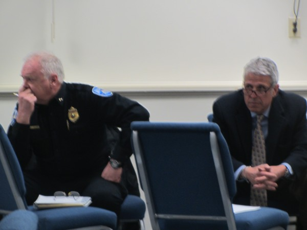 Rockland Police Chief Bruce Boucher (left) and Oceanside High School East Principal Tom Forti listen during a Tuesday night meeting in Rockland to discuss school safety.