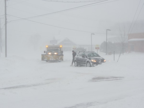 A motorist has to shovel out his car that got stuck in a snow that had drifted onto the travel lane of Maverick Street in Rockland on Saturday morning. Drifts in the area were near four feet in places while other areas were bare.