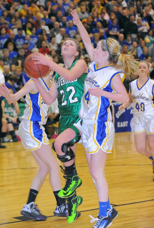 Schenck's Taylor McLaughiln (left) drives for the basket past Washburn's Mackenzie Worcester during the second half of the game in Bangor on Saturday morning, Feb. 23, 2013.