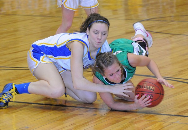 Washburn's Olivia Doody (left) and Schenck's Ashley Leavitt scramble for the ball during the first half of the game in Bangor on Saturday morning, Feb. 23, 2013.