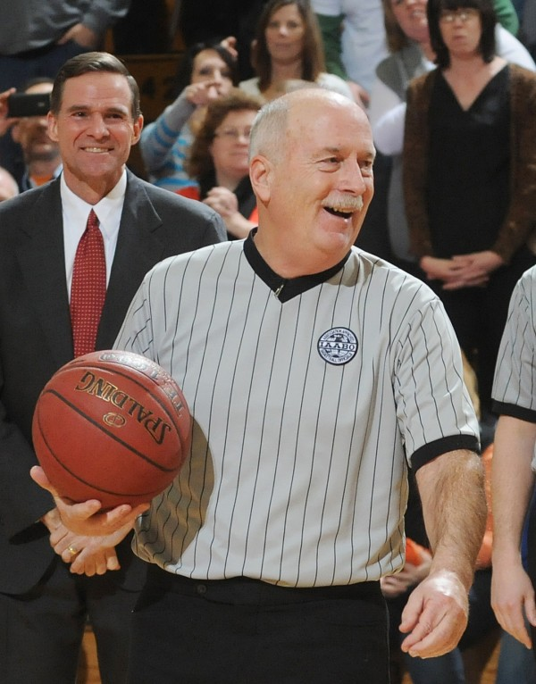 Veteran high school basketball referee John Shoppe of Lamoine participates in pregame ceremonies at the Bangor Auditorium on Thursday, Feb.7, 2013. Shoppe has returned to his home in Lamoine, a week after he suffered a serious heart attack while refereeing the Camden Hills-Oceanside girls Class B Eastern Maine quarterfinal on Feb. 15 at the Bangor Auditorium.