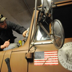 """Maine Department of Transportation plow truck driver Brian Austin uses furniture polish to clean his plow truck windows and mirrors. He says the wax does not let ice and snow build up on the glass. """"Plowin's my thing,"""" Austin said."""