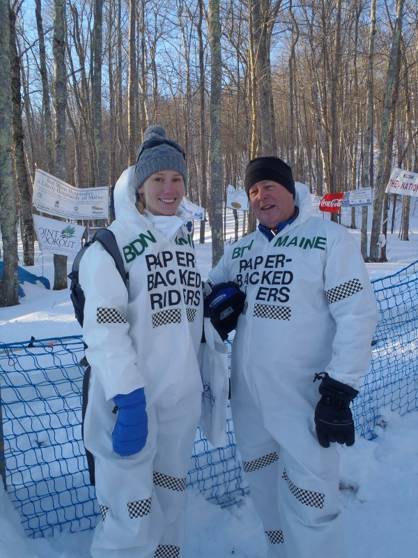 BDN reporter Aislinn Sarnacki and BDN Outdoor Editor John Holyoke pose in their costumes as the &quotPaper-backed Riders&quot toboggan team on Feb. 10, 2013, before their turn down the chute at the U.S. National Toboggan Championships at the Camden Snow Bowl in Camden.