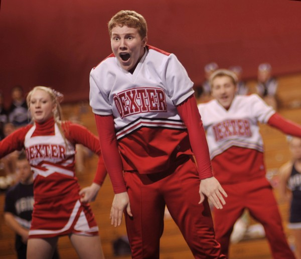 David McKusick, front and center, performs with his teammates in the Eastern Maine Class C Regional Cheerleading Championships at the Bangor Auditorium in 2012.