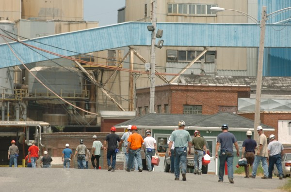 Millworkers return to the Lincoln Paper and Tissue mill in Lincoln after a lunch break.