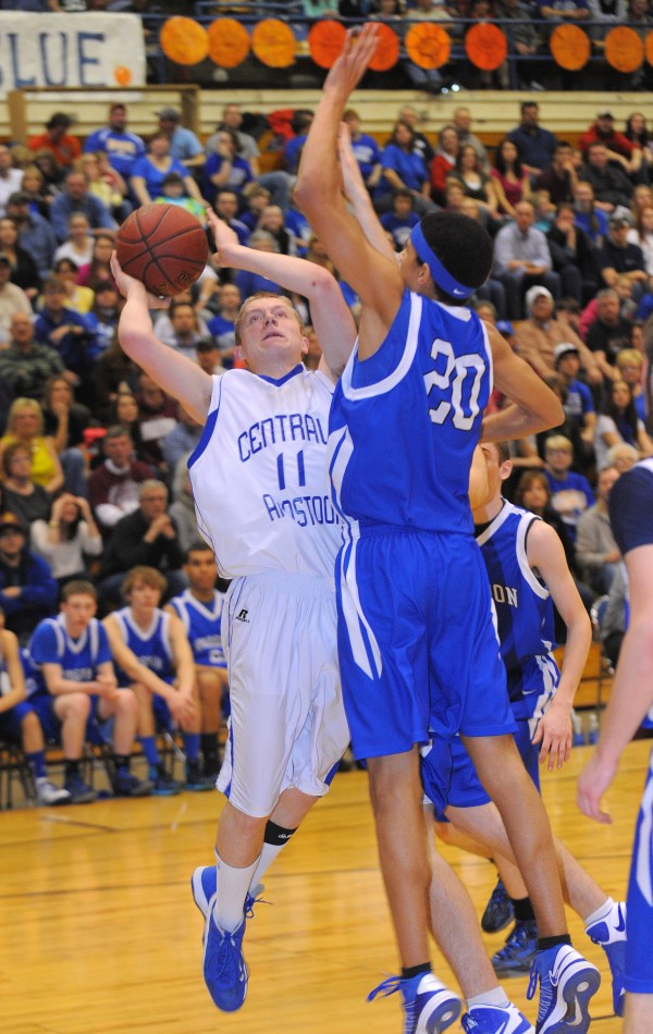 Central Aroostook's Joe Stiles (left) tries to make a shot over Hodgdon's Chris Hudson during the second half of the game in Bangor on Saturday, Feb, 23, 2013. Central Aroostook won the game 58-55 in overtime.