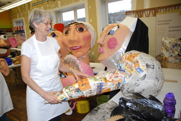 Claudette Morin works on the paper-mache creation that will eventually become a large mosquito &quotbig head.&quot Morin is part of an ongoing workshop in Madawaska creating the giant heads that will be a big part of the 2014 World Acadian Congress.