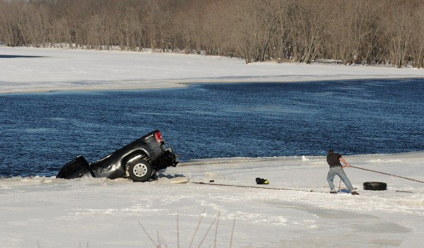 A pickup truck is removed from the Penobscot River in Passadumkeag on Sunday. The truck was removed from the river around noon after the body of the driver was taken out by divers. The driver, 75-year-old Gerald Crommett, had been reported missing Saturday.