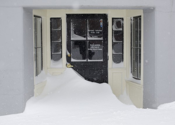 The doorway to Massimo's Breads in downtown Bangor was covered with snow after a winter storm hit the city early Saturday morning.