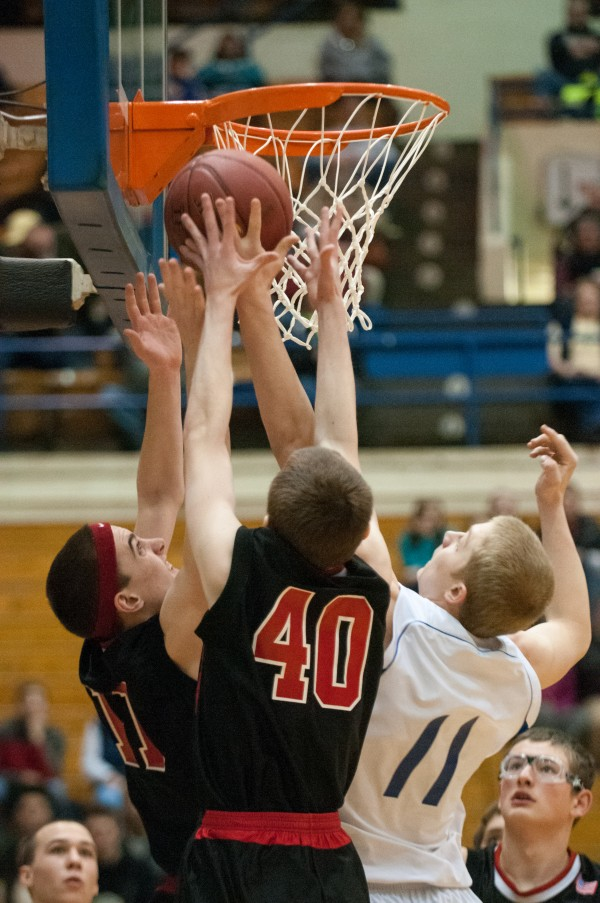 Katahdin's Wyatt Morse (left) and Central Aroostook's Joe Stiles (right) battle for a rebound at the Bangor Auditorium on Monday, Feb. 18, 2013.