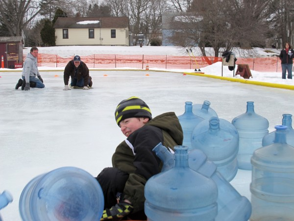Thomas Hilton, 7, smashes into the &quotpins&quot during Human Bowling at the ice rink in Knowlton Park during Ellsworth's Winter Carnival on Sept. 16, 2013.
