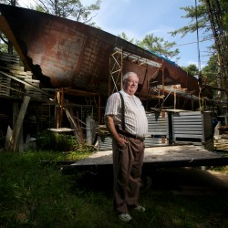 Harold Arndt stands in front of his 113-foot-long, unfinished, steel schooner made completely out of reclaimed materials in a residential Freeport neighborhood in July 2012. Arndt has been working on the boat for almost 20 years.