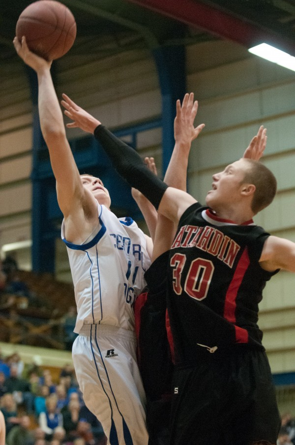 Central Aroostook's Joe Stiles (left) attempts a layup against Katahdin at the Bangor Auditorium on Monday, Feb. 18, 2013.