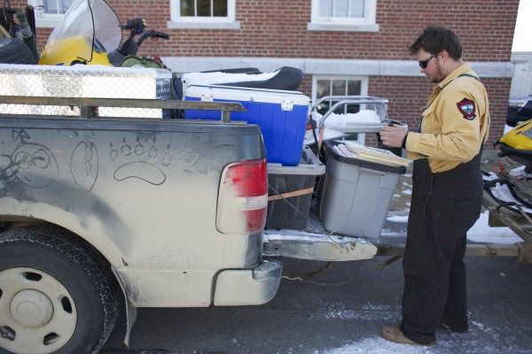 Phillip &quotGriz&quot Adams finishes packing for a weeklong trip to the Ashland area to study Maine black bears and their cubs at his office in Bangor.