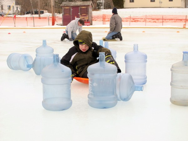 Thomas Hilton crashes into the &quotpins&quot during Human Bowling at Ellsworth Winter Carnival in Knowlton Park on Feb. 16, 2013.