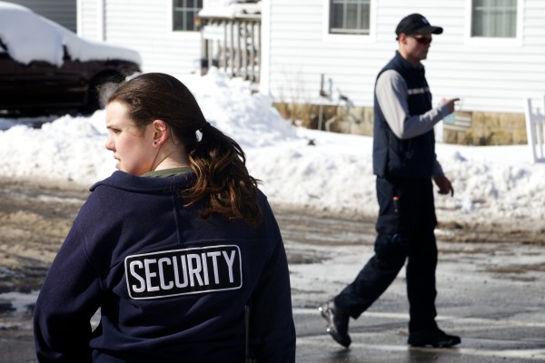 Southern Maine Community College security directs traffic Monday morning in South Portland as the campus is evacuated after the school received bomb threats.