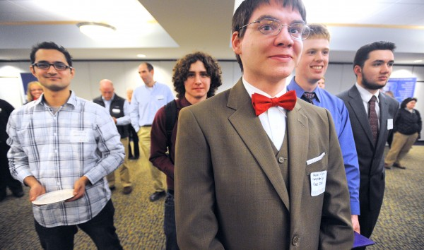 Daniel Clark (foreground), a computer engineering major at the University of Maine, was among the students who attended the University of Maine kick-off event for Project>Login on Monday.