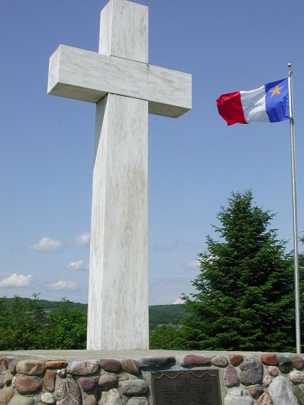 An Acadian flag flies near the granite Acadian Cross on the southern bank of the St. John River in Madawaska in July 2004.