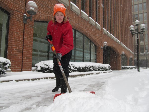 Gloria Pearse removes snow from walkways in Portland's Canal Plaza Friday morning, Feb. 8, 2013. Pearse, who at the age of 23 has visited all 50 states, said she can't pick a favorite. A Friday-Saturday nor'easter is forecast to hit the state she's currently in with 12 inches of more of snow.