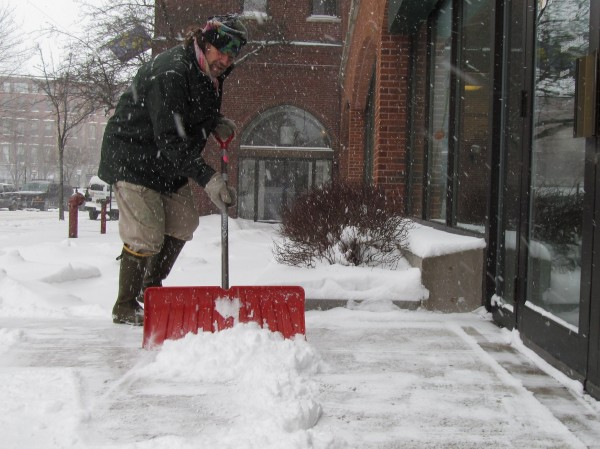 Zoo Cairn shovels snow outside Fidelity Investments, near Middle Street in Portland, on Friday, Feb. 8, 2013. Cairn, an artist and writer, said he hopes the nor'easter brings two feet of snow or more. &quotI love it,&quot he said. &quotIt's winter in Maine.&quot