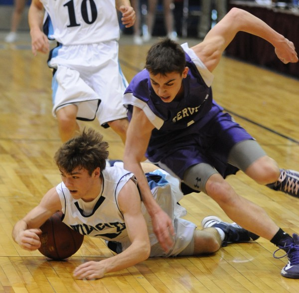 Presque Isle's Jonah Stephenson and Waterville's Jordan Derosby scramble for a loose ball in first-half action of the boys Class B quarterfinal game at the Bangor Auditorium Saturday morning.