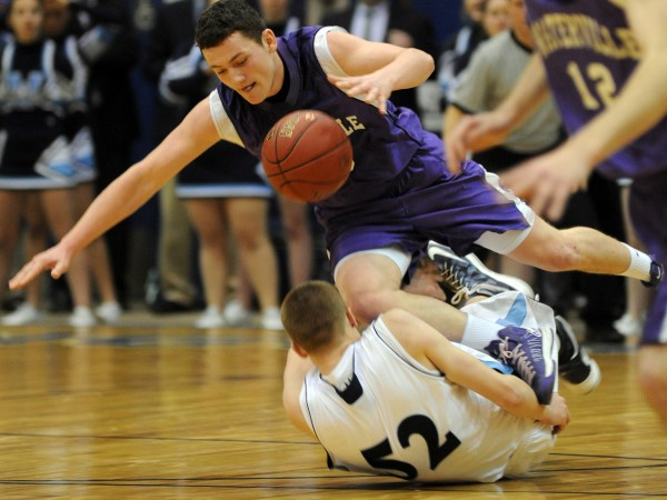 Waterville's Josh Gormley and Presque Isle's Bradley Shields get tripped up in second half action of the boys Class B quarterfinal game at the Bangor Auditorium Saturday morning.