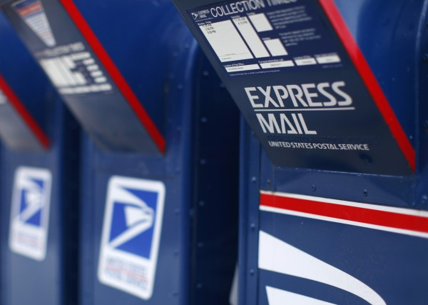 U.S. Postal Service mail boxes at a post office in Encinitas, Calif., on Feb. 6, 2013. The Postal Service plans to drop Saturday delivery of first-class mail by August in its latest effort to cut costs after losing nearly $16 billion last fiscal year, the cash-strapped mail agency said.