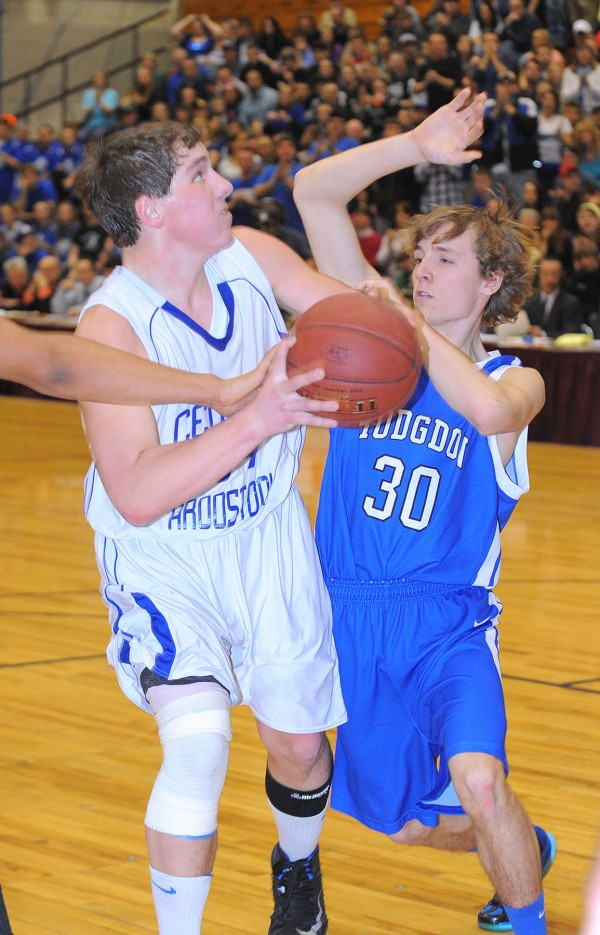 Central Aroostook's Zack Mcclung (left) drives on Hodgdon's Devon R. Quint during the first half of the game in Bangor on Saturday, Feb, 23, 2013. Central Aroostook won the game 58-55 in overtime.