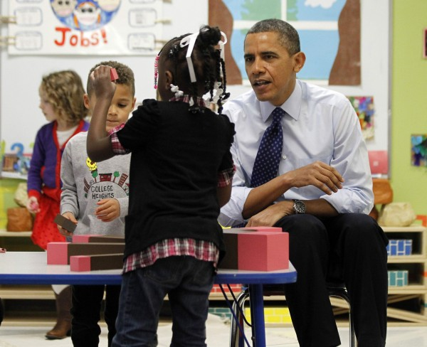 President Barack Obama meets with children in a pre-kindergarten classroom at College Heights early childhood learning center in Decatur, Georgia, February 14, 2013. Obama flew to Georgia to push his plan to ensure high-quality preschool, unveiled during his State of the Union address this week.