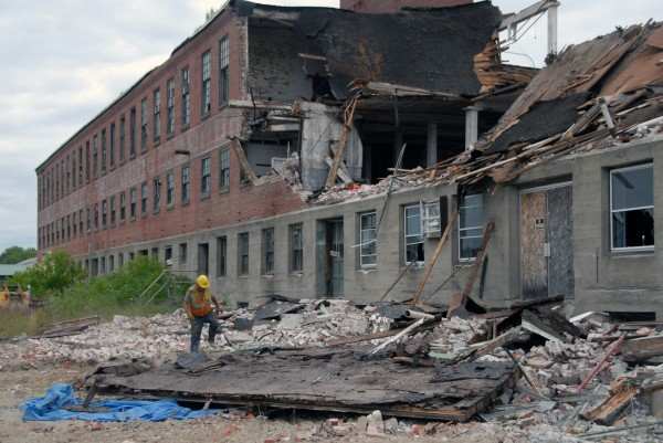 Tom Pelkey of Eddington, an equipment operator with J.E. Butler LLC of Holden, spent most of the day watching for and helping gather recyclable debris at the former Howland tannery building in July 2012.