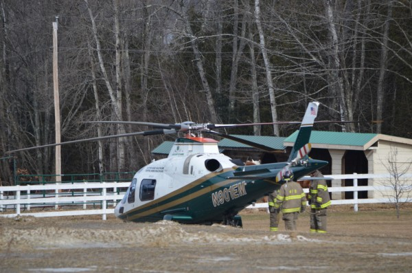 Newport firefighters gather around a LifeFlight helicopter slated to transport a man who was badly burned by a torch in Newport on Friday, Feb. 1, 2013.