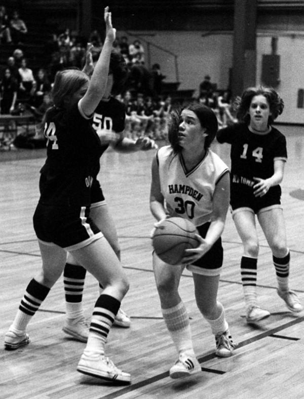 Hampden Academy's Cindy Rand drives past Old Town's Debbie Trafton (left) during an Eastern Maine Class A semifinal on Feb. 16, 1976. Rand led Hampden to the victory and then a state-title win over Mt. Blue 66-65 in overtime on Feb. 26.