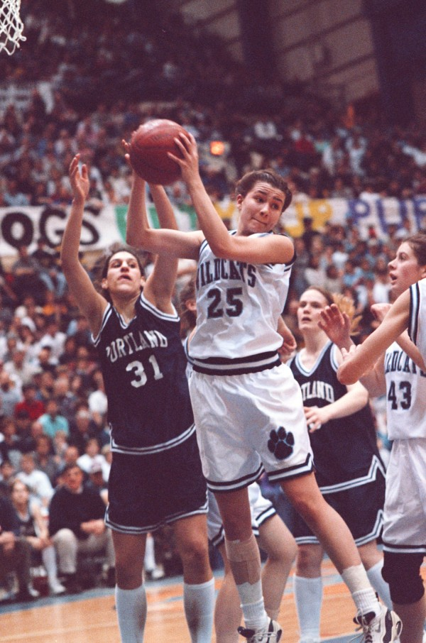 Presque Isle's Kim Condon grabs a rebound in front of Portland's Jami Arnold during the Class A state final on March 15, 1997. Condon led PI to victory after helping the Wildcats beat Old Town in the regional final the week before after putting sliced potatoes on her injured right ankle.
