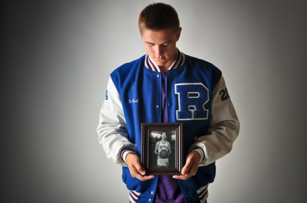 Jonesport-Beals basketball standout Garet Beal holds a photo of his dad, Lindell Beal, who died in July at age 43.