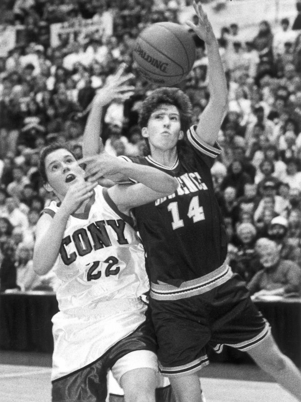 Lawrence's Cindy Blodgett (right) gets to the ball before Cony's Kelly Duffy during the Eastern Maine Class A final before a crowd of 6,000 on March 12, 1994 at the Bangor Auditorium. Blodgett scored 47 points to help Lawrence win 78-69.