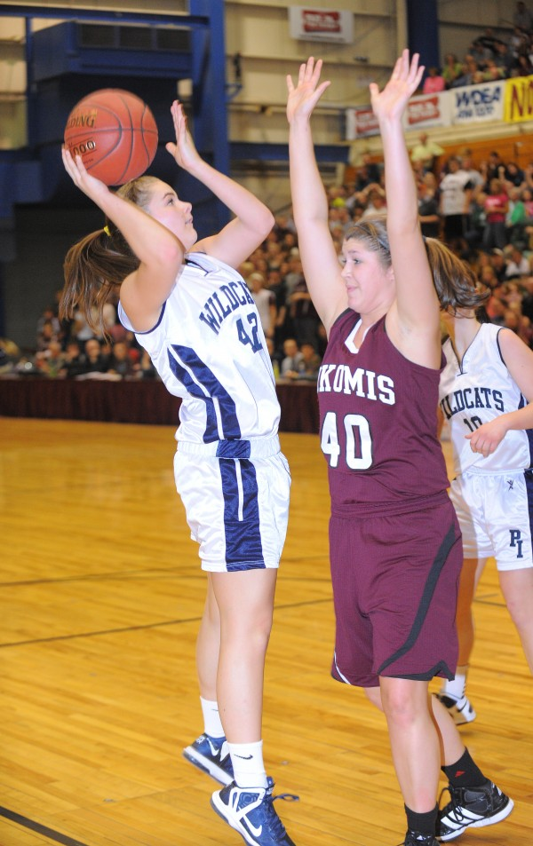 Presque Isle's Krystal Kingsbury (left) goes up for a shot  over Nokomis' Anna Mackenzie during the first half of the Eastern Maine Class B championship game in Bangor on Saturday, Feb, 23, 2013.