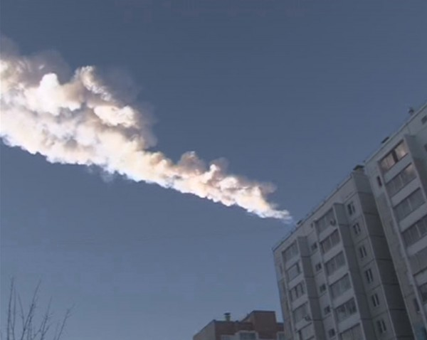The trail of a meteor is seen above a residential apartment block in the Urals city of Chelyabinsk, in this still image taken from video shot on Feb. 15, 2013. A powerful blast rocked from an exploding meteor the Russian region of the Urals early on Friday, emergency officials said.