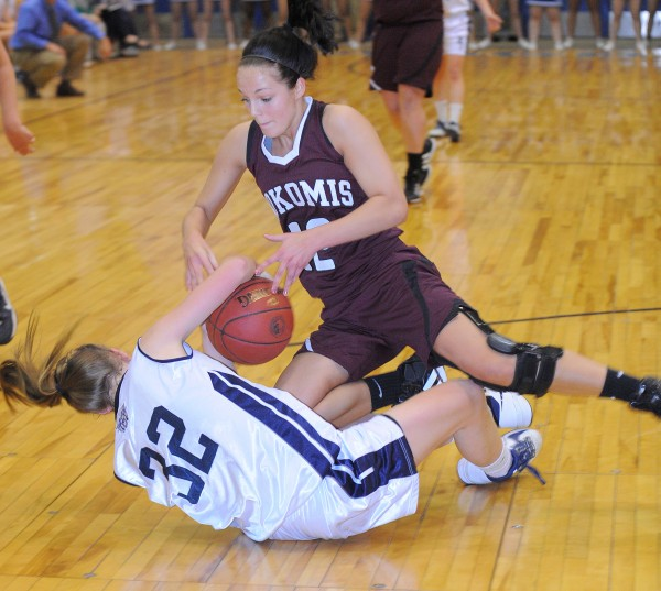 Nokomis' Kylie Richards (top) and Presque Isle's Hannah Graham fall on the floor as they scramble for the ball during the first half of the Eastern Maine Class B championship game in Bangor on Saturday, Feb. 23, 2013.