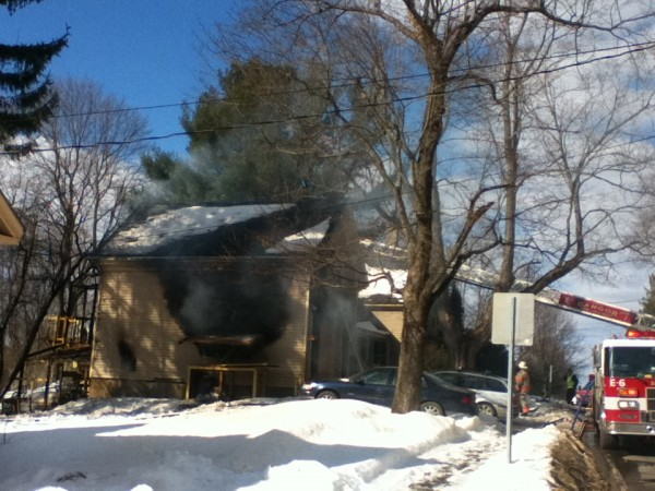 Bangor firefighters work to extinguish a Kenduskeag Avenue blaze on Wednesday afternoon.