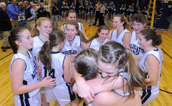 Presque Isle players celebrate their victory over Nokomis in the Eastern Maine Class B championship game in Bangor on Saturday, Feb, 23, 2013.