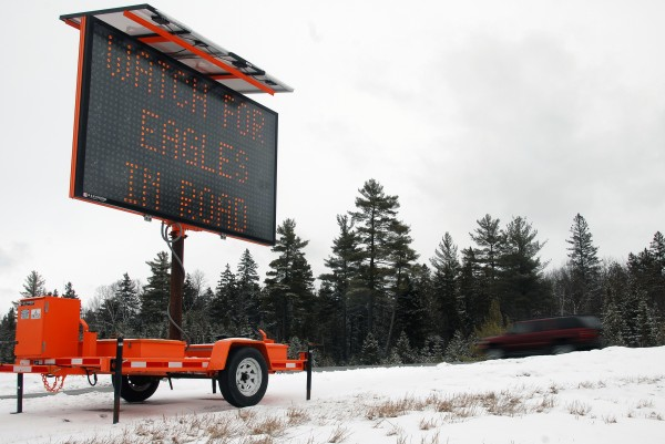 In an attempt to keep motorists from hitting eagles, state officials have set up a variable message sign newly set near mile 242 on Interstate 95 in Medway, seen here on Sunday, Feb. 24, 2013.